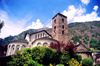 Andorra la Vella: St Esteve Church / Església de St. Esteve - tower and three Romanesque apses and a medieval belfry altered by architect Josep Puig i Cadafalch in 1940 - photo by M.Torres