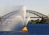 Australia - Sydney (NSW): tug boat show and Harbour Bridge - water jets - photo by A.Walkinshaw