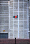 Dakha / Dacca, Bangladesh: Bangladeshi flag, a blood stain over Muslim green against the brutalist architecture of the National Assembly of Bangladesh - Jatiyo Sangshad Bhaban - photo by M.Torres