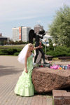 Belarus - MBelarus - Minsk - Isle of Tears - crying angel and bride - traditionaly newlyweds visit war memorials on their wedding day - photo by A.Dnieprowsky