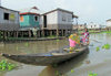 Ganvie, Benin: houses on stilts in the the African Venice - pirogue on Lake Nokoué - UNESCO World Heritage Tentative List - photo by G.Frysinger