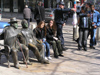 Sofia: people and statues on a bench - photo by J.Kaman