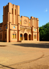 Ouagadougou, Burkina Faso: façade of the Catholic Cathedral of the Immaculate Conception of Ouagadougou - built in mudbrick, with two steeples of different heights, neo romanesque style - built by Monseigneur Joanny Thévenoud of the White Fathers - photo by M.Torres