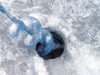 Northwest Territories, Canada: ice fishing - ice auger - hole drilled in the ice - photo by Air West Coast