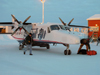 Fort Good Hope, Northwest Territories, Canada: preparing a Dornier 228 in cold weather - Summit Air - photo by Air West Coast