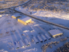 Northwest Territories, Canada: frozen aerodrome and hangars seen from the air - long shadows - photo by Air West Coast
