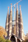 Catalonia - Barcelona: the Sacred Family Cathedral - always escorted by a crane / Sagrada Familia - Temple Expiatori de la Sagrada Família - the Passion façade - photo by Miguel Torres