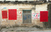 China - Hainan Island: wall with red posters (photo by G.Friedman)