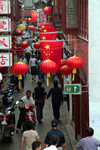 Shanghai, China: Old Qibao town - red lanterns and red flags - photo by Y.Xu