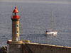 Corsica - Bastia: lighthouse and boat leaving port - photo by J.Kaman