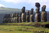 Easter island / Ilha da Pascoa / Isla de Pascua - Tonguriki: ahu - line of statues - In the background (to the East) is the extinct volcanic peak of Puakatiri - moais - Unesco world heritage site - photo by Roe Eime
