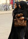 Eritrea - Asmara: black clad Muslim girls walking in the street - photo by E.Petitalot