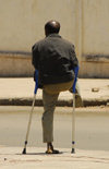 Eritrea - Asmara: handicapped man - war amputation - photo by E.Petitalot