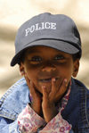 Eritrea - Asmara: smilling boy with a police cap - photo by E.Petitalot