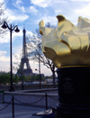 France - Paris: Eiffel tower and liberty flame - photo by K.White