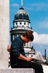 Germany - Berlin: Gendarmenmarket - man reading a newspaper in Midtown of Berlin - French Cathedral / Französischer Dom - Huguenot church and museum - photo by W.Schmidt