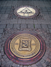 Bad Kreuznach - Rhineland-Palatinate / Rheinland-Pfalz, Germany / Deutschland: decorative manholes on a granite pavement - photo by Efi Keren