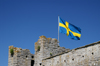 Gotland - Visby: Swedish flag on a tower of the eastern wall - photo by A.Ferrari