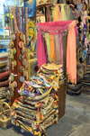 Greece, Rhodes, Old Town:richly coloured fabric wares on sale in an Old Town shop - photo by P.Hellander