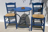 Greece, Dodecanese Islands,Kos: two chairs and table against wall - photo by P.Hellander