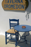 Greece, Dodecanese Islands,Kos: chair, table and restaurant sign - Taverna Oromedon - photo by P.Hellander