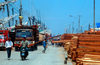 Sunda Kelapa, South Jakarta, Indonesia - timber being unloaded from phinisi boats - old port of Sunda Kelapa - photo by B.Henry