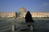 Iran - Isfahan: woman on a bench in Naghsh-i Jahan Square, looking at Sheikh Lotf Allah Mosque at nigh - photo by W.Allgower