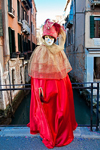 Carnival participant with Carnival costume on bridge overlooking canal, Venice - photo by A.Beaton
