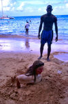 Jamaica - Montego Bay: girl buried in the sand (photo by Francisca Rigaud)