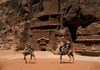 Jordan - Petra: tourists on camels - photo by J.Wreford