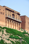 Erbil / Hewler, Kurdistan, Iraq: Erbil Citadel - old brick building with arches and balcony - Qelay Hewlêr - UNESCO world heritage site - photo by M.Torres
