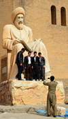 Erbil / Hewler / Arbil / Irbil, Kurdistan, Iraq: Kurdish men have their picture taken with the statue of the historian Ibn Al-Mustawfi aka Mubarak Ben Ahmed Sharaf-Aldin at the entrance to Arbil Citadel - Qelay Hewlêr - UNESCO world heritage site - photo by M.Torres