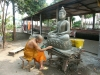 Laos - Luang Probang: monk working on a Buddha statue - UNESCO World Heritage Site - photo by P.Artus
