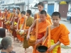 Laos - Luang Prabang: monks collecting food donations - people giving alms - photo by P.Artus