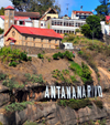 Antananarivo / Tananarive / Tana - Analamanga region, Madagascar: Hollywood style Antananarivo sign on the cliffs - Ampamarinana protestant church and the falaise de Ampamarinana - photo by M.Torres