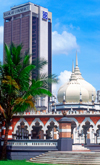Masjid Jamek mosque and the Bank of Commerce building - city center, Kuala Lumpur, Malaysia - photo by B.Lendrum