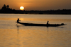 Mopti, Mali: canoe silhouette on the Niger river at sunset - photo by J.Pemberton