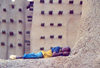 Djenné, Mopti Region, Mali: boy sleeping at the mosque - mud architecture - photo by N.Cabana