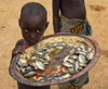 Djenné cercle, Mopti Region, Mali: boy selling river fish in village near Djenne - photo by J.Pemberton