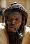 Djenné, Mopti Region, Mali: portrait of a medicine man smoking a pipe at monday market - photo by J.Pemberton