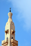 Nouakchott, Mauritania: slender minaret with bronze crescent of the Saudi Mosque aka Grand Mosque - King Faisal avenue and Mamadou Konate street - la Mosquée Saoudienne - photo by M.Torres