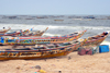 Nouakchott, Mauritania: traditional wooden fishing boats aligned along the beach - fishing harbor, the Port de Pêche - photo by M.Torres