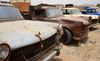 Nouakchott, Mauritania: rusting 1960s French pick-up trucks by the fishing harbor - Peugeot 404 - photo by M.Torres