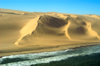 Namibia: Aerial view of Skeleton Coast - beach - Ocean meets Sand dunes - photo by B.Cain