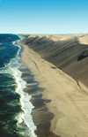 Namibia: Aerial view of Skeleton Coast - Ocean meets Sand dunes - looking north, Kunene region - photo by B.Cain