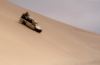 Namibia: Landrover going down sand dune, Skeleton Coast - photo by B.Cain