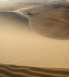 Namibia: Sand dune scenic with people and land rover, Skeleton Coast - photo by B.Cain
