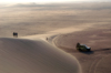 Namibia: sand dune scenic, people, land rover, Skeleton Coast - photo by B.Cain
