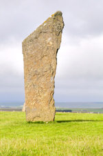 Orkney island, Mainland- Standing Stones of Stenness - Standing at a maximum height of six metres(around 19 feet) on the south-eastern shore of the Stenness Loch, onlyfour of the ring's original 12 stones remain. Radio-carbon dates have shownthat the site dates from at least 3100B - photo by Carlton McEachern