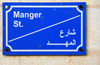 Bethlehem, West Bank, Palestine: Manger street - sign in English and Arabic - odonym - photo by M.Torres
